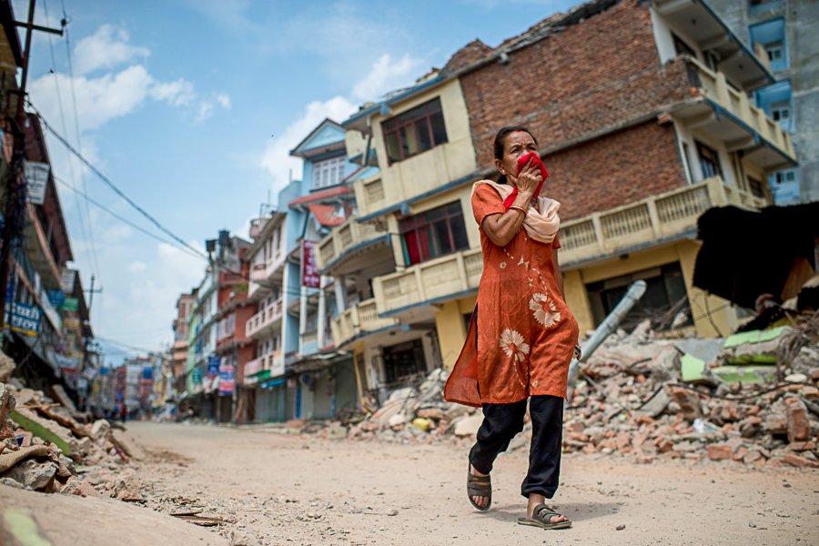 KATHMANDU, NEPAL - MAY 13:  People walk past the rubble of destroyed buildings following a second major earthquake May 13, 2015 in Kathmandu, Nepal. A 7.3 magnitude earthquake struck in Nepal only two weeks after more than 8,000 people were killed in a devastating earthquake. The latest quake struck near Mt Everest near the town of Namche Bazar. Tremors were felt as far away as Bangladesh and Delhi. (Photo by Jonas Gratzer/Getty Images)