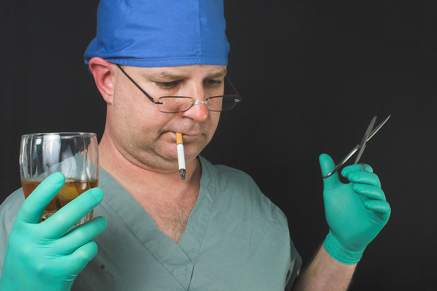 A surgeon who has obviously had a little too much to drink.